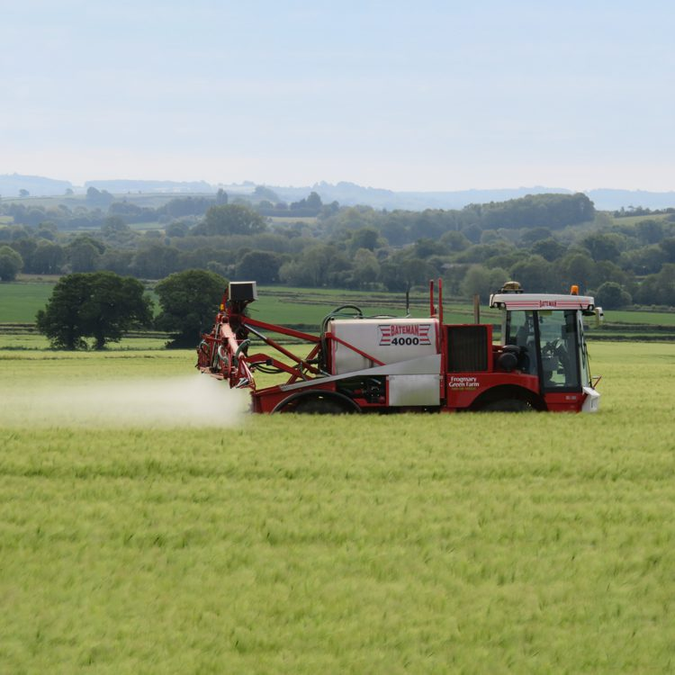 Frogmary spraying tractors in wheat field