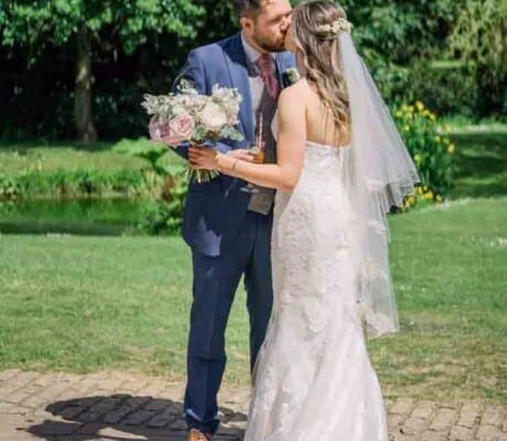 Wedding couple getting married at Haselbury Mill