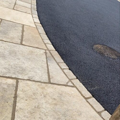 Tarmac Driveway with Indian sandstone pathway and brick edging
