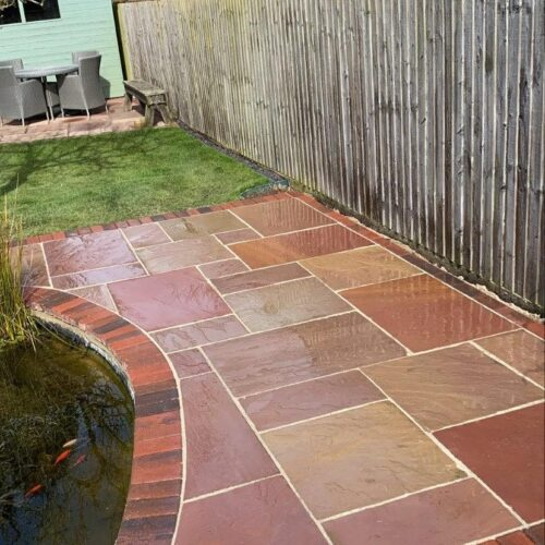 Beautiful Indian sandstone paving with brick edging