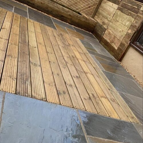 Indian block paved patio with decking area and gravel edges